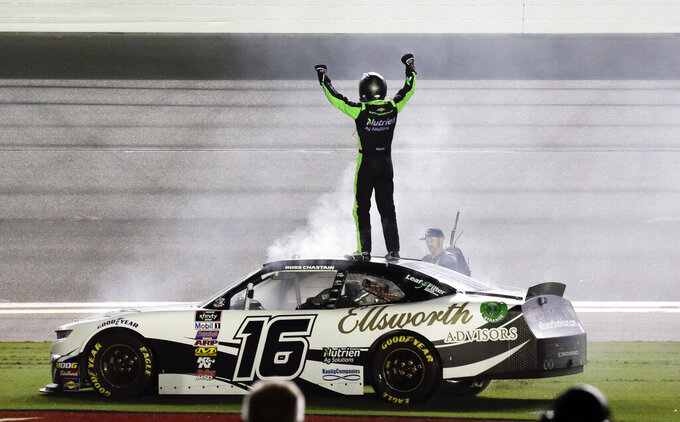 Ross Chastain celebrates on top of his car in front of fans after winning the NASCAR Xfinity Series auto race at Daytona International Speedway, Saturday, July 6, 2019, in Daytona Beach, Fla. (AP Photo/Terry Renna)