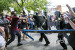 Protesters and police clash in Columbia, S.C., Sunday, May 31, 2020. People protested against police brutality sparked by the death of George Floyd at the hands of police in Minneapolis on May 25. (Jason Lee/The Sun News via AP)