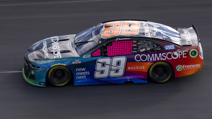 Daniel Suarez (99) drives during a NASCAR Cup Series auto racing race at Charlotte Motor Speedway, Monday, Oct. 11, 2021, in Concord, N.C. (AP Photo/Matt Kelley)