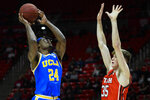 UCLA forward Jalen Hill (24) shoots over Utah center Branden Carlson (35) during the first half of an NCAA college basketball game Thursday, Feb. 20, 2020, in Salt Lake City. (AP Photo/Alex Goodlett)
