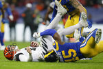 Cincinnati Bengals quarterback Andy Dalton, left, is sacked by Los Angeles Rams linebacker Obo Okoronkwo during the second half of an NFL football game, Sunday, Oct. 27, 2019, at Wembley Stadium in London. (AP Photo/Tim Ireland)