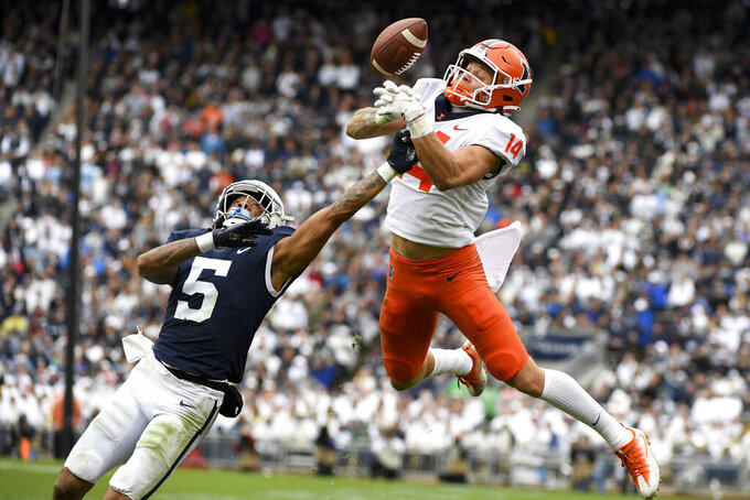 Penn State cornerback Tariq Castro-Fields (5) breaks up a pass intended for Illinois wide receiver Casey Washington (14) during the second half of an NCAA college football game in State College, Pa.on Saturday, Oct. 23, 2021. Illinois defeated Penn State 20-18 in nine overtimes. (AP Photo/Barry Reeger)
