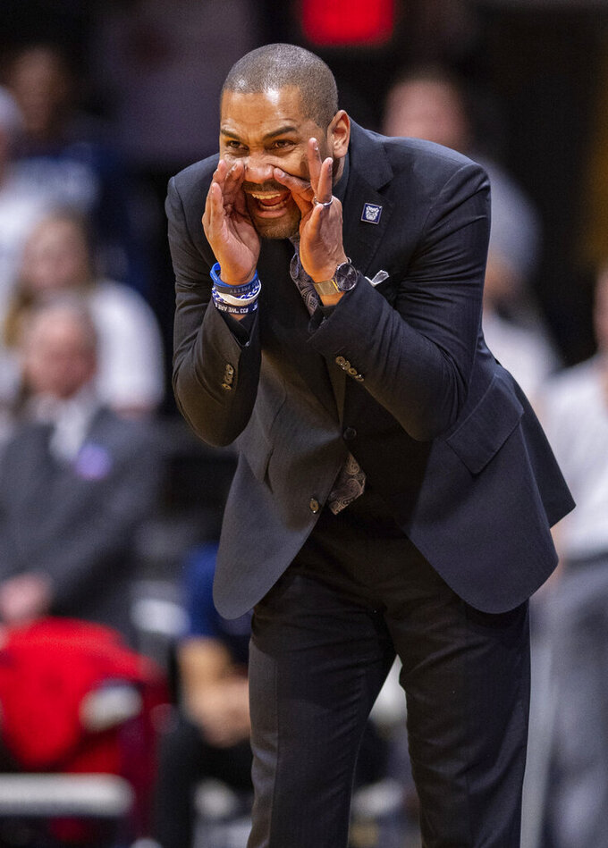 Butler head coach LaVall Jordan communicates with his players on the court during the first half of an NCAA college basketball game against DePaul, Saturday, Feb. 29, 2020, in Indianapolis. (AP Photo/Doug McSchooler)