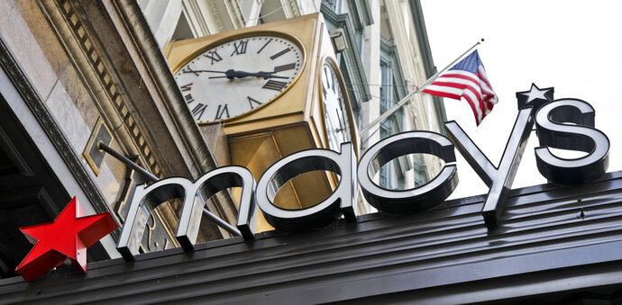 FILE- This May 2, 2017, file photo shows corporate signage at Macy's flagship store in Manhattan, in New York. Macy's Inc. reports earnings Wednesday, May 16, 2018. (AP Photo/Bebeto Matthews, File)