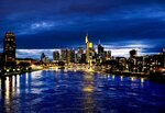 The buildings of the banking district with the Commerzbank building in the center are illuminated in Frankfurt, Germany, late Sunday, March 17, 2019. (AP Photo/Michael Probst)
