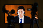 Swimmer Sun Yang from China is seen on a video screen as he speaks during a public hearing at the Court of Arbitration for Sport (CAS) in Montreux, Switzerland, Friday, Nov. 15 2019. One of China's biggest Olympic stars and three-time gold medalist swimmer Sun Yang is facing a World Anti-Doping Agency appeal in Switzerland that seeks to ban him for up eight years for allegedly refusing to give samples voluntarily. (Jean-Christophe Bott/Keystone via AP)