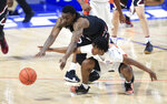 South Carolina guard Jermaine Couisnard dives over Florida guard Tyree Appleby for the ball during the second half of an NCAA college basketball game Wednesday, Feb. 3, 2021, in Gainesville, Fla. (AP Photo/Matt Stamey)