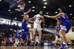 Pepperdine guard Keith Smith (11) grabs a rebound next to BYU guard Connor Harding (44) during the first half of an NCAA college basketball game Saturday, Feb. 29, 2020, in Malibu, Calif. (AP Photo/Ringo H.W. Chiu)