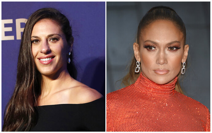 In this combination of file photos Carli Lloyd smiles prior to the women's soccer World Cup France 2019 draw, in Boulogne-Billancourt, outside Paris, on Dec. 8, 2018 and Jennifer Lopez attends the CFDA Fashion Awards at the Brooklyn Museum on June 3, 2019, in New York. Lloyd of the U.S. women's national soccer team celebrated her recent World Cup victory with a lap dance from J. Lo. Lopez pulled Lloyd from the audience to the stage at Madison Square Garden in New York on Friday, July 12, 2019, working her sensual moves on the soccer star.  (AP Photo)