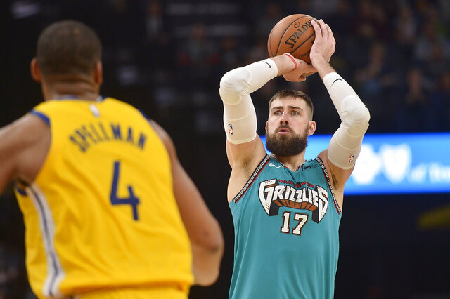 Memphis Grizzlies center Jonas Valanciunas (17) shoots ahead of Golden State Warriors forward Omari Spellman (4) in the second half of an NBA basketball game Sunday, Jan. 12, 2020, in Memphis, Tenn. (AP Photo/Brandon Dill)