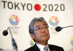 FILE - This is a Thursday, Jan. 10, 2013 file photo of Tsunekazu Takeda, President of the Tokyo 2020 Olympic games bid, as he listens to a question from the media during their first international presentation of the Tokyo 2020 Olympic Games bid in London. France's financial crimes office says International Olympic Committee member Takeda is being investigated for corruption related to the 2020 Tokyo Olympics. The National Financial Prosecutors office says Takeda, the president of the Japanese Olympic Committee, was placed under formal investigation for
