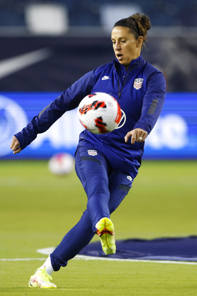 United States' Carli Lloyd warms up before an international friendly soccer match against South Korea in Kansas City, Kan., Thursday, Oct. 21, 2021. (AP Photo/Colin E. Braley)