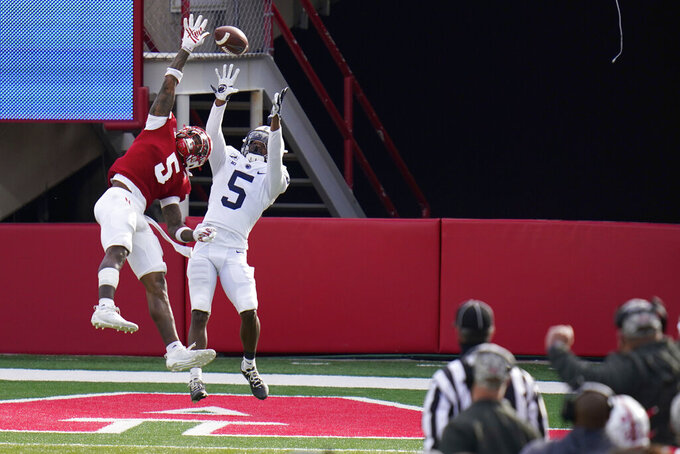 A pass to Penn State wide receiver Jahan Dotson (5) sails high, as Nebraska cornerback Cam Taylor-Britt (5) defends, during the second half of an NCAA college football game in Lincoln, Neb., Saturday, Nov. 14, 2020. Nebraska won 30-23. (AP Photo/Nati Harnik)