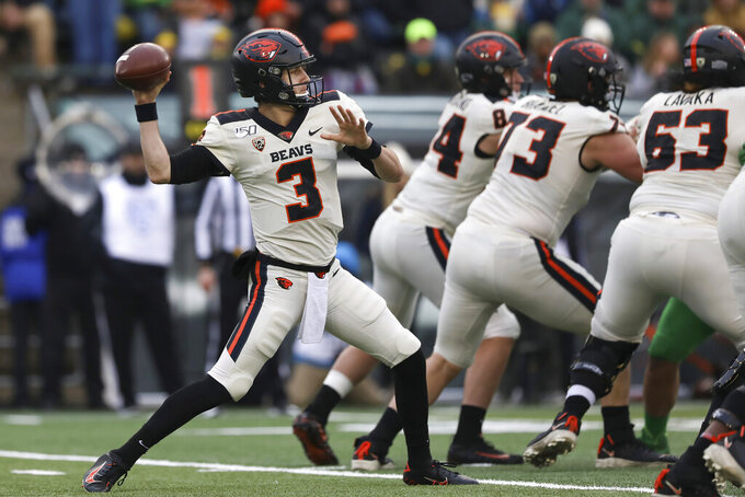 FILE - In this Nov. 30, 2019, file photo, Oregon State quarterback Tristan Gebbia (3) throws a pass during the second half of an NCAA college football game against Oregon in Eugene, Ore. The uncertainty for the Beavers is centered on the offense. Quarterback Jake Luton has moved on to the Jacksonville Jaguars and Gebbia, at least for now, looks like the frontrunner going into the abbreviated season. (AP Photo/Amanda Loman, File)
