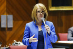 FILE - Rep. Heather Carter, R-Cave Creek, speaks in the House during budget deliberations at the Arizona Capitol Tuesday, May 3, 2016, in Phoenix. The biggest knock-down, drag-out primary fight among the 90 Senate and House seats up for grab in November pits two sitting Republican lawmakers in a suburban north Phoenix district battling for the soul of the GOP base.   (AP Photo/Ross D. Franklin, File)