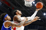 Dayton's Obi Toppin, right, shoots against Drake's Anthony Murphy, left, during the first half of an NCAA college basketball game, Saturday, Dec. 14, 2019, in Dayton, Ohio. (AP Photo/John Minchillo)