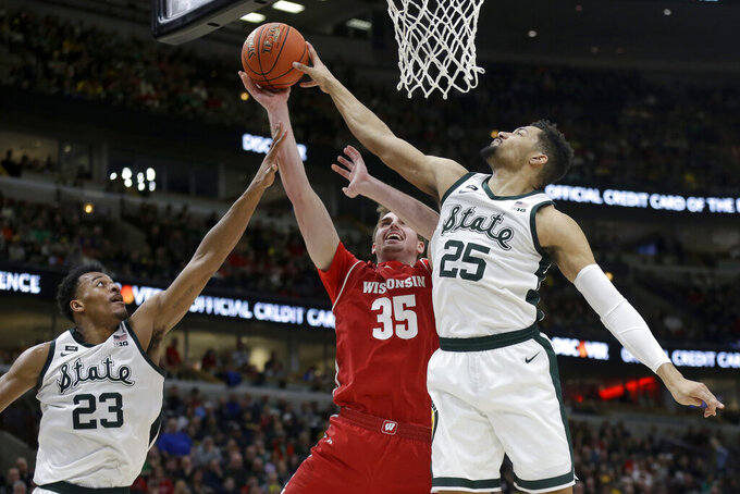 Michigan State's Kenny Goins (25) blocks a shot by Wisconsin's Nate Reuvers (35) during the second half of an NCAA college basketball game in the semifinals of the Big Ten Conference tournament, Saturday, March 16, 2019, in Chicago. (AP Photo/Kiichiro Sato)