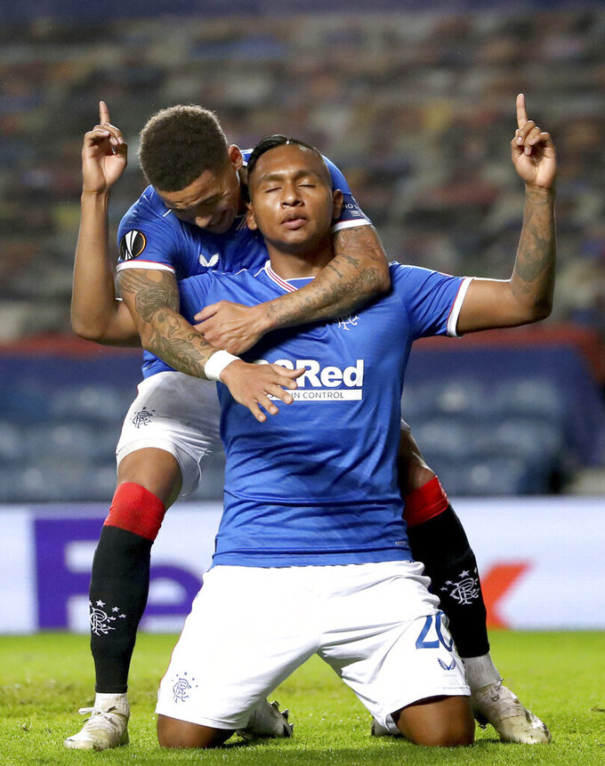 Rangers' Alfredo Morelos, front, celebrates scoring his side's first goal of the game against Lech Poznan, with teammate James Tavernier, during their Europa League soccer match at Ibrox Stadium in Glasgow, Scotland, Thursday Oct. 29, 2020. (Andrew Milligan/PA via AP)