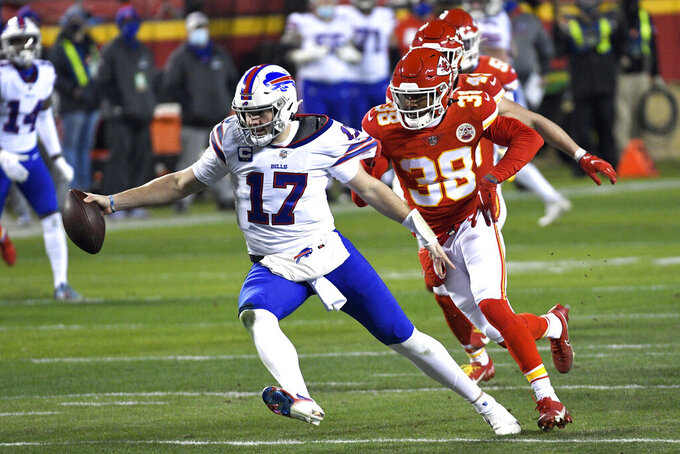 Buffalo Bills quarterback Josh Allen (17) is sacked by Kansas City Chiefs safety L'Jarius Sneed (38) during the first half of the AFC championship NFL football game, Sunday, Jan. 24, 2021, in Kansas City, Mo. (AP Photo/Reed Hoffmann)