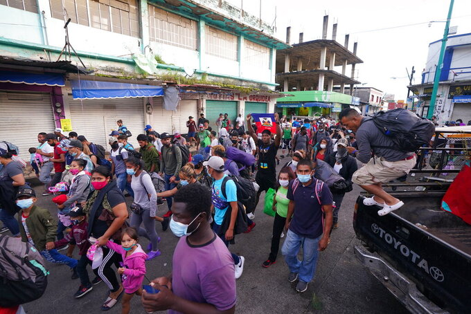 A caravan of migrants head north towards the U.S.-Mexico border, as they depart from Tapachula, Mexico, Saturday, Sept. 4, 2021. (AP Photo/Marco Ugarte)