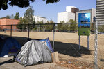 A homeless person's tent sits just outside Grand Park, Wednesday, Oct. 28, 2020, in Los Angeles. Los Angeles is again considering a proposal to greatly restrict where homeless people may camp in public places around Los Angeles - rules that opponents say would criminalize homelessness. (AP Photo/Chris Pizzello)