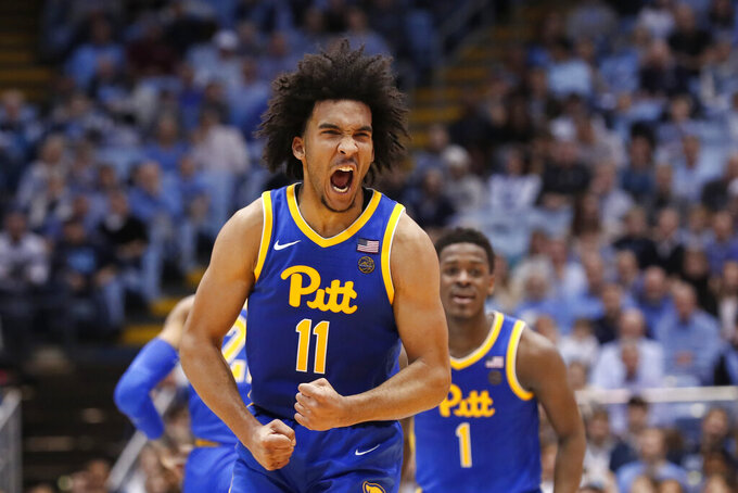 Pittsburgh guard Justin Champagnie (11) reacts following a basket against North Carolina during the second half of an NCAA college basketball game in Chapel Hill, N.C., Wednesday, Jan. 8, 2020. (AP Photo/Gerry Broome)