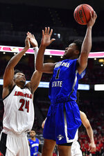 Indiana State center Tre Williams (1) shoots over Louisville forward Dwayne Sutton (24) during the first half of an NCAA college basketball game in Louisville, Ky., Wednesday, Nov. 13, 2019. (AP Photo/Timothy D. Easley)