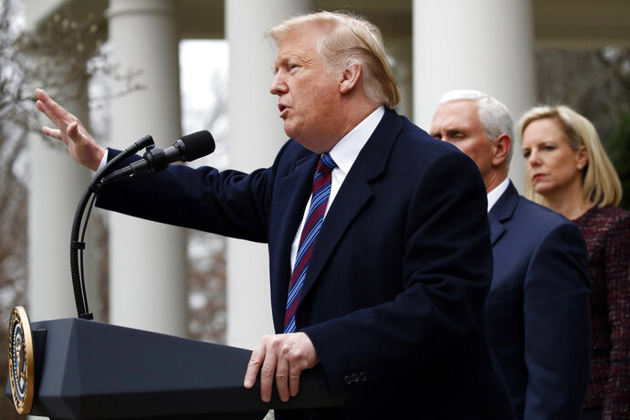President Donald Trump speaks in the Rose Garden of the White House, as Vice President Mike Pence and Homeland Security Secretary Kirstjen Nielsen listen, after a meeting with Congressional leaders on border security, Friday, Jan. 4, 2019, at the White House in Washington. (AP Photo/Jacquelyn Martin)