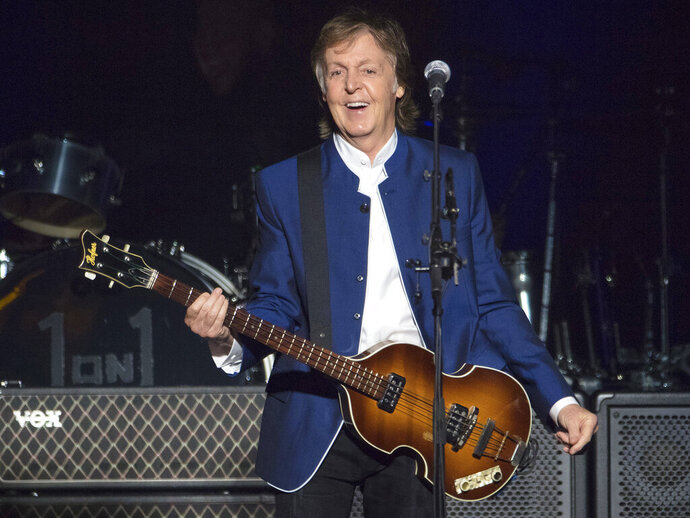 """FILE - In this Monday, July 10, 2017 file photo, Paul McCartney performs at Amalie Arena in Tampa, Fla. USA. McCartney is writing his first stage musical, an adaptation of classic movie """"It's a Wonderful Life"""", it is announced Thursday July 18, 2019. (AP Photo/Scott Audette, FILE)"""