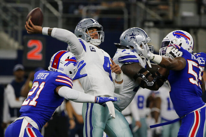 Buffalo Bills safety Jordan Poyer (21) applies pressures Dallas Cowboys quarterback Dak Prescott (4) throws a pass in the first half of an NFL football game in Arlington, Texas, Thursday, Nov. 28, 2019. (AP Photo/Michael Ainsworth)