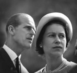 FILE - In this June 20, 1959 file photo, Britain's Queen Elizabeth and Prince Philip are pictured in Schefferville, as they listen to an explanation on the workings of an iron ore mine on another stop in their royal tour of Canada. Buckingham Palace officials say Prince Philip, the husband of Queen Elizabeth II, has died, it was announced on Friday, April 9, 2021. He was 99. Philip spent a month in hospital earlier this year before being released on March 16 to return to Windsor Castle. Philip, also known as the Duke of Edinburgh, married Elizabeth in 1947 and was the longest-serving consort in British history.  (AP Photo/File)