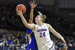 FILE - In this Sunday, Jan. 19, 2020, file photo, Connecticut's Anna Makurat (24) shoots during the first half of an NCAA college basketball game against Tulsa, in Storrs, Conn. All but one of Anna Makurat's teammates headed home after the NCAA canceled this year's postseason basketball tournament and the school suspended classes amid the COVID-19 pandemic. For the 19-year-old UConn freshman from Poland, the decision was not that easy, especially with ever-increasing travel restrictions to and from Europe. She worried about classes restarting while she was overseas and when — or if — she might be able to get back to campus.   (AP Photo/Stephen Dunn, File)