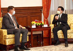 In this photo released by the Taiwan Ministry of Foreign Affairs, Taiwan's Foreign Minister Joseph Wu, right, meets with U.S. Undersecretary of State Keith Krach in Taipei, Taiwan on Friday, Sept. 18, 2020. China's military sent 18 planes including fighter jets over the Taiwan Strait in an unusually large show of force Monday as a U.S. envoy held a day of closed-door meetings on the self-governing island claimed by China. (Taiwan Ministry of Foreign Affairs via AP)