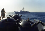 FILE - This Sept. 21, 1987 file photo shows mines aboard the Iranian ship Iran Ajr being inspected by a boarding party from the USS Lasalle in the Persian Gulf. The U.S. Navy is trying to put together a new coalition of nations to counter what it sees as a renewed maritime threat from Iran. Meanwhile, Iran finds itself backed into a corner and ready for a possible conflict. It stands poised on Friday, Sept. 6, 2019, to further break the terms of its 2015 nuclear deal with world powers. (AP Photo/Mark Duncan, File)