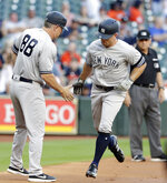 New York Yankees third base coach Phil Nevin (88) congratulates New York Yankees' Brett Gardner, right, as he rounds the bases after his home run against the Houston Astros during the inning of a baseball game Wednesday, April 10, 2019, in Houston. (AP Photo/Michael Wyke)