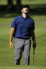 Tony Romo reacts after missing a birdie putt from below the 17th green during the first round of the Safeway Open PGA golf tournament Thursday, Sept. 26, 2019, in Napa, Calif. (AP Photo/Eric Risberg)