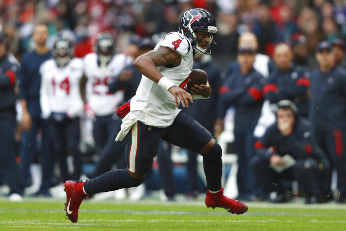 Houston Texans quarterback Deshaun Watson (4) runs down field against the Jacksonville Jaguars during the first half of an NFL football game at Wembley Stadium, Sunday, Nov. 3, 2019, in London. (AP Photo/Ian Walton)