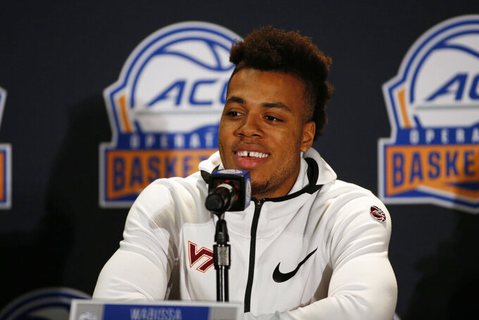 Virginia Tech player Wabissa Bede answers a question during the Atlantic Coast Conference NCAA college basketball media day in Charlotte, N.C., Tuesday, Oct. 8, 2019. (AP Photo/Nell Redmond)
