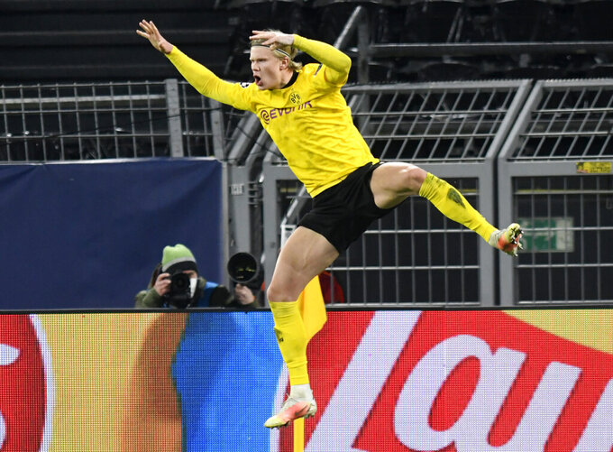 Dortmund's Erling Haaland celebrates after scoring his sides second goal during the Champions League, round of 16, second leg soccer match between Borussia Dortmund and Sevilla FC in Dortmund, Germany, Tuesday, March 9, 2021. (Bernd Thissen/Pool via AP)