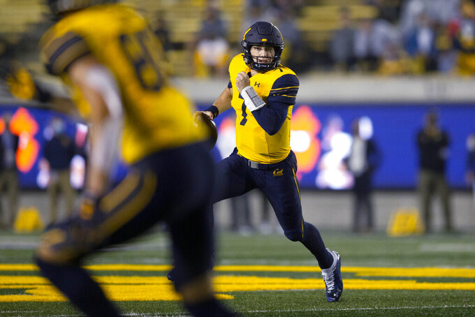 California quarterback Chase Garbers (7) run out of the pocket during the first quarter of the team's NCAA college football game against Nevada, Saturday, Sept. 4, 2021, in Berkeley, Calif. (AP Photo/D. Ross Cameron)