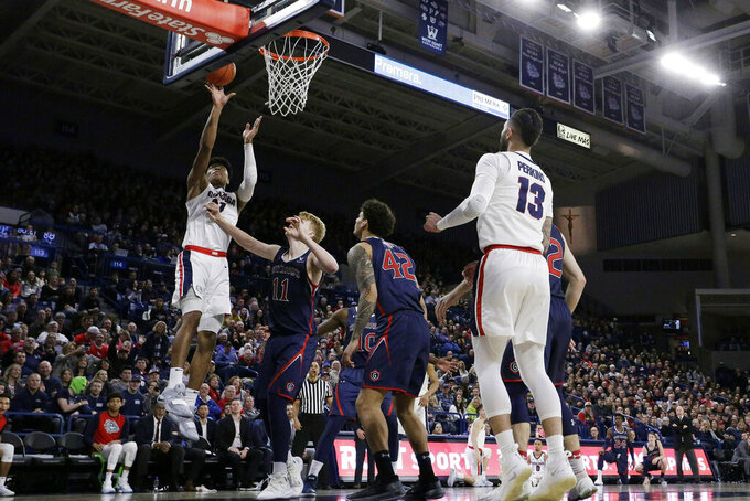 Gonzaga forward Rui Hachimura, left, shoots over Saint Mary's forward Matthias Tass (11) during the second half of an NCAA college basketball game in Spokane, Wash., Saturday, Feb. 9, 2019. Gonzaga won 94-46. (AP Photo/Young Kwak)