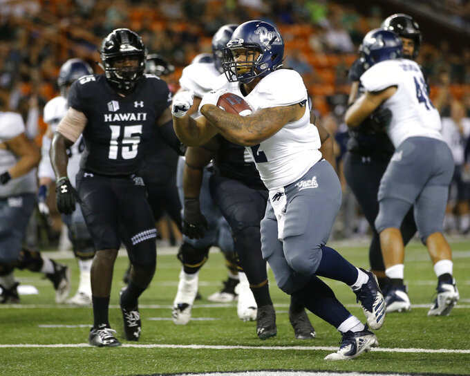 Nevada running back Devonte Lee (2) makes a touchdown against Hawaii during the second quarter of an NCAA college football game Saturday, Oct. 20, 2018, in Honolulu. (AP Photo/Marco Garcia)
