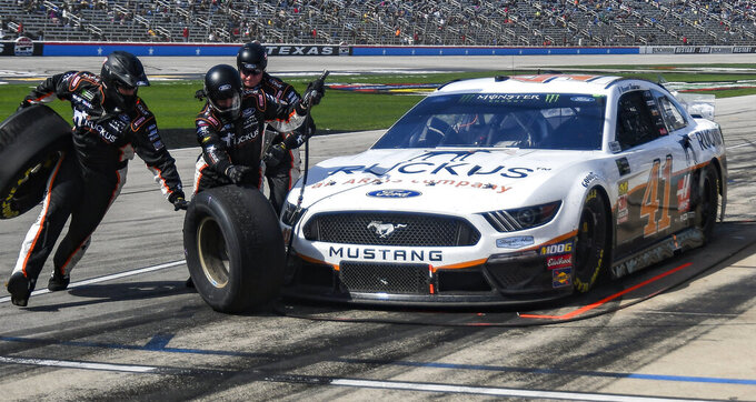 Driver Daniel Suarez's pit crew service his car during a NASCAR Cup auto race at Texas Motor Speedway, Sunday, March 31, 2019, in Fort Worth, Texas. (AP Photo/Randy Holt)