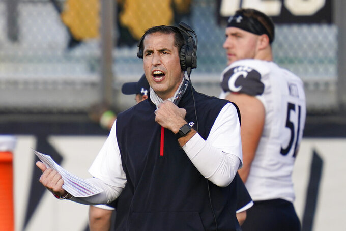 FILE - Cincinnati head coach Luke Fickell shouts instructions to his players during the first half of an NCAA college football game against Central Florida in Orlando, in this Saturday, Nov. 21, 2020, file photo. Fickell knew he might surprise some by suggesting No. 11 Georgia is the best team Cincinnati has faced in his four seasons as head coach. (AP Photo/John Raoux, File)