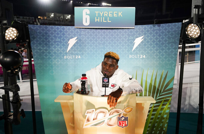 Kansas City Chiefs' Tyreek Hill speaks to reporters during Opening Night for the NFL Super Bowl 54 football game Monday, Jan. 27, 2020, at Marlins Park in Miami. (AP Photo/David J. Phillip)