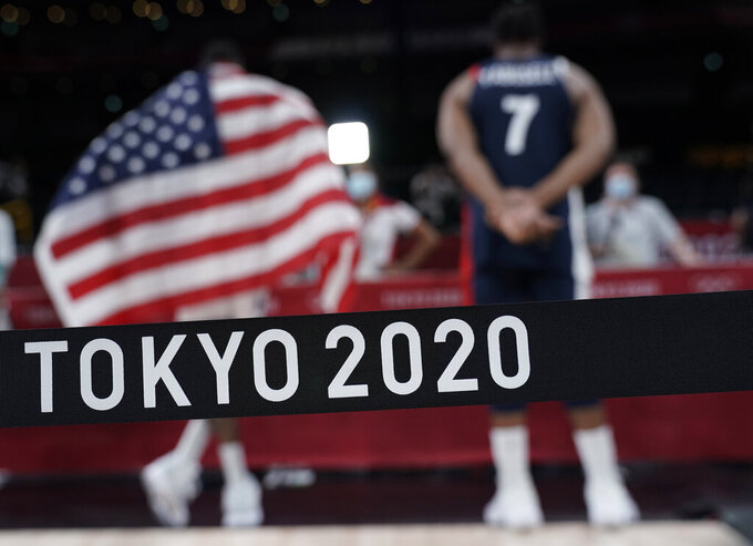 FILE - In this Aug. 7, 2021,  file photo, United States' Kevin Durant (7) and France's Guerschon Yabusele (7) give interviews after United States won the men's basketball gold medal game at the 2020 Summer Olympics in Saitama, Japan. (AP Photo/Eric Gay, File)
