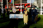 A demonstrator wearing a U.S. President Donald Trump mask and crown takes part in a protest organized by the Stop the War coalition against the British government carrying out airstrikes on targets in Syria, in Parliament Square, London, Monday, April 16, 2018. British Prime Minister Theresa May faced restive lawmakers on Monday to justify her decision to launch airstrikes against Syria without a vote in Parliament. (AP Photo/Matt Dunham)