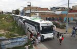 In this April 30, 2020 photo, Venezuelan migrants board buses departing to the Venezuelan border amid the new coronavirus pandemic, in Bogota, Colombia. About 20,000 Venezuelans returned home since early March due to the pandemic's economic fallout. (AP Photo/Fernando Vergara)