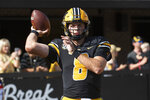 Missouri quarterback Connor Bazelak warms up before the start of an NCAA college football game against SE Missouri Saturday, Sept. 18, 2021, in Columbia, Mo. (AP Photo/L.G. Patterson)