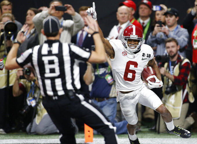 FILE - In this Jan. 8, 2018, file photo, Alabama wide receiver DeVonta Smith (6) celebrates after scoring the game-winning touchdown  during overtime of the NCAA college football playoff championship game against Georgia in Atlanta. Saturday's SEC Championship, is the game the Bulldogs have wanted since last January, when the Alabama pulled out a 26-23 overtime victory in the national championship game.  (Joshua L. Jones/Athens Banner-Herald via AP, File)